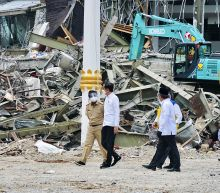 After seeing floods, Indonesian leader visits quake zone