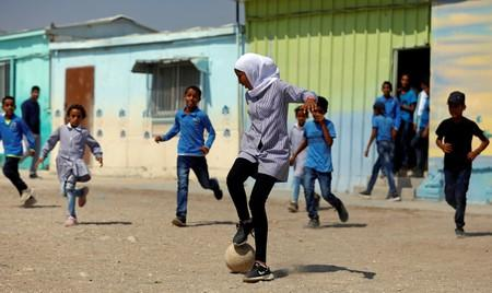 Palestinian students play soccer at their school in Jordan Valley in the Israeli-occupied West Bank