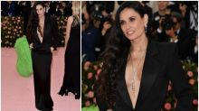 Demi Moore, 56, stuns in plunging black gown at Met Gala