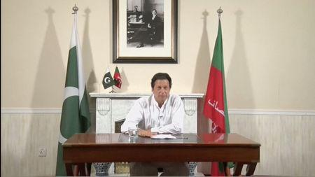 Cricket star-turned-politician Imran Khan, chairman of Pakistan Tehreek-e-Insaf (PTI), gives a speech as he declares victory in the general election in Islamabad, Pakistan, in this still image from a July 26, 2018 handout video by PTI. PTI handout/via REUTERS TV