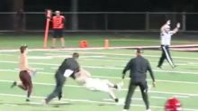 High school football coach faces backlash over viral video of him tackling a student