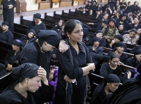 Mourners react at the Sacred Family Church for the funeral of Coptic Christians who were killed on Friday in Minya, Egypt, May 26, 2017. REUTERS/Mohamed Abd El Ghany