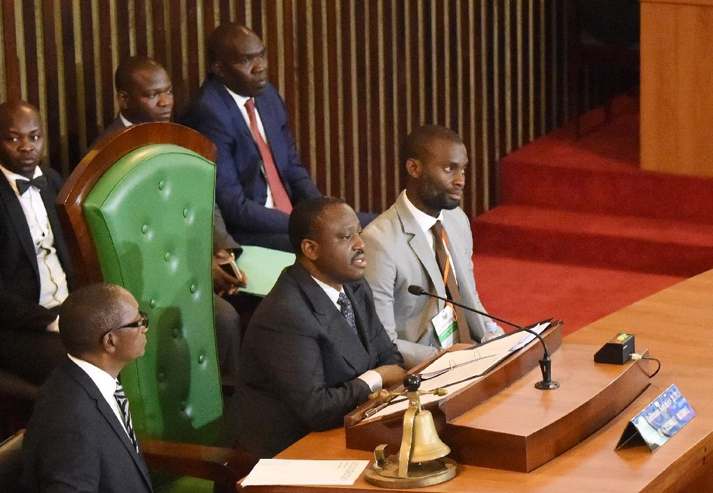 Guillaume Soro (C) addresses lawmakers after being reelected speaker in Abidjan on January 9, 2017 (AFP Photo/SIA KAMBOU)