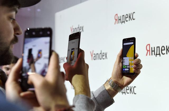 Putin signs law requiring Russian apps on smartphones, TVs and PCs