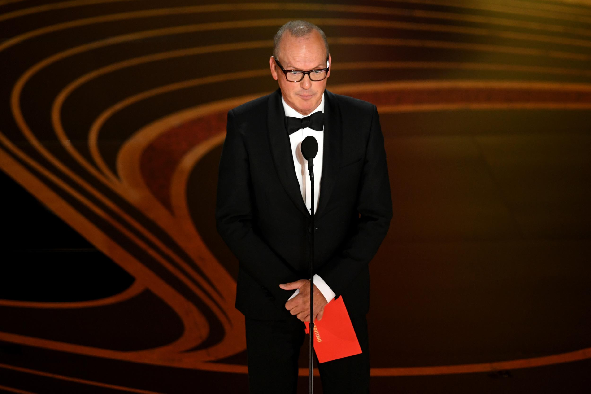 HOLLYWOOD, CALIFORNIA - FEBRUARY 24: Michael Keaton speaks onstage during the 91st Annual Academy Awards at Dolby Theatre on February 24, 2019 in Hollywood, California. (Photo by Kevin Winter/Getty Images)