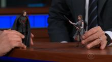 Adam Driver and Stephen Colbert act out a 'Star Wars' scene with figurines