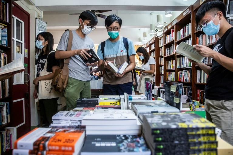 China's new security law has cast a threatening shadow over Hong Kong's dynamic book industry (AFP Photo/ISAAC LAWRENCE)