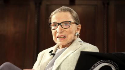 Ginsburg returns to work, refutes conspiracy theories