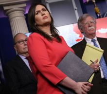 White House press secretary Sarah Sanders questioned by investigators probing Russian election meddling