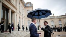 France's Macron: I will not surrender my umbrella