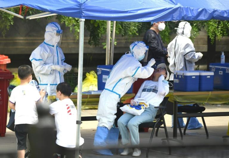 Beijing's coronavirus testing capacity has been expanded to 90,000 a day, according to Xinhua (AFP Photo/Noel Celis)