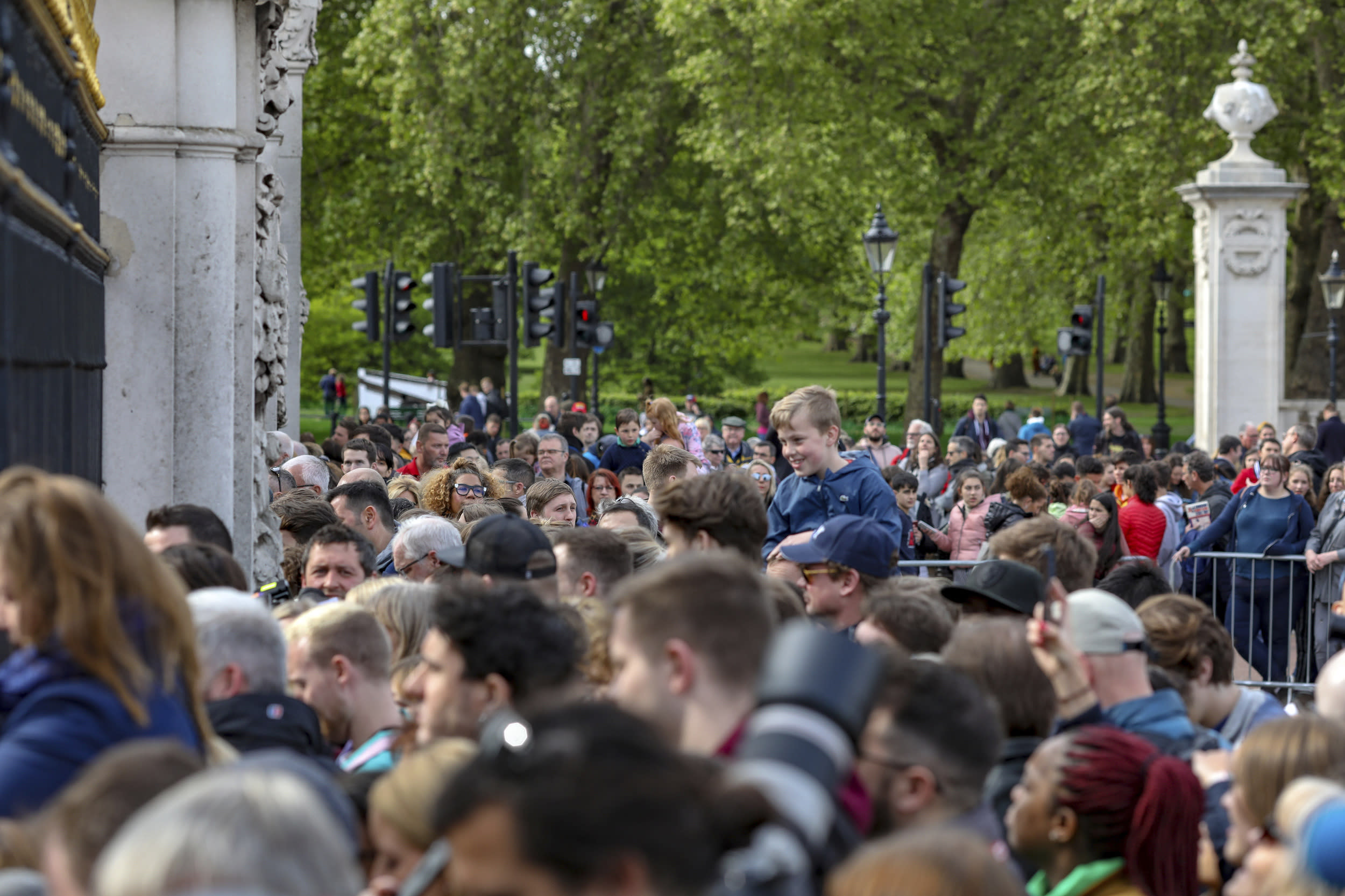 Well wishers gather outside the gates of Buckingham Palace in London, Monday May 6, 2019, after Prince Harry announced that his wife Meghan, Duchess of Sussex, has given birth to a boy.  (AP Photo/Vudi Xhymshiti)