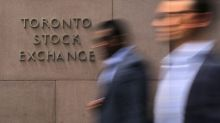 TSX edges higher as material shares gain on higher gold prices