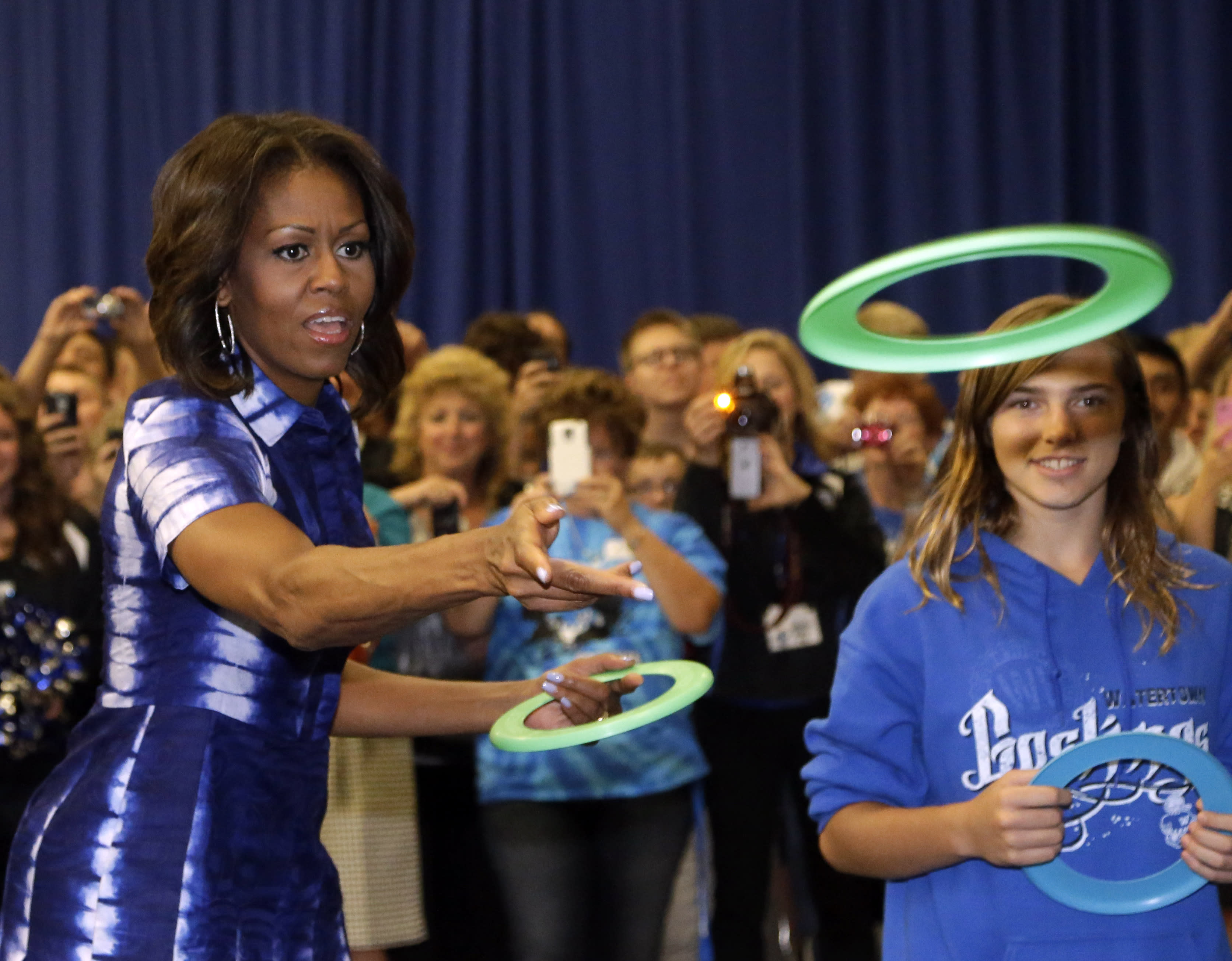 First Lady Michelle Obama partakes in an event at Watertown High School to encourage people to drink more water, Thursday, Sept. 12, 2013, in Watertown, Wis. (AP Photo/Morry Gash)