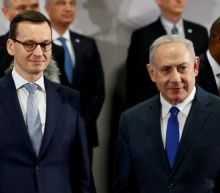 Poland pulls out of Israel summit in row over WW2 role