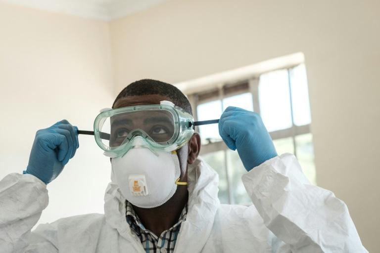 Virus threat: A lab technician gears up for visiting a quarantine ward at the Kenyatta National Hospital in Nairobi (AFP Photo/Yasuyoshi CHIBA)