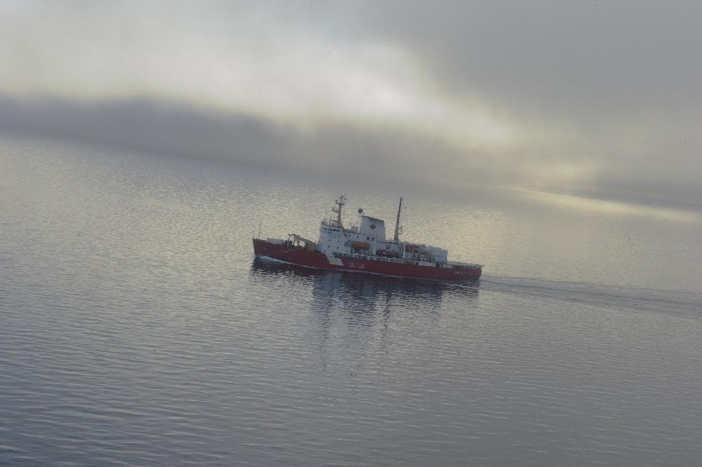 A Canadian research ice-breaker navigating in an ice-free passage through the Arctic Ocean in 2015