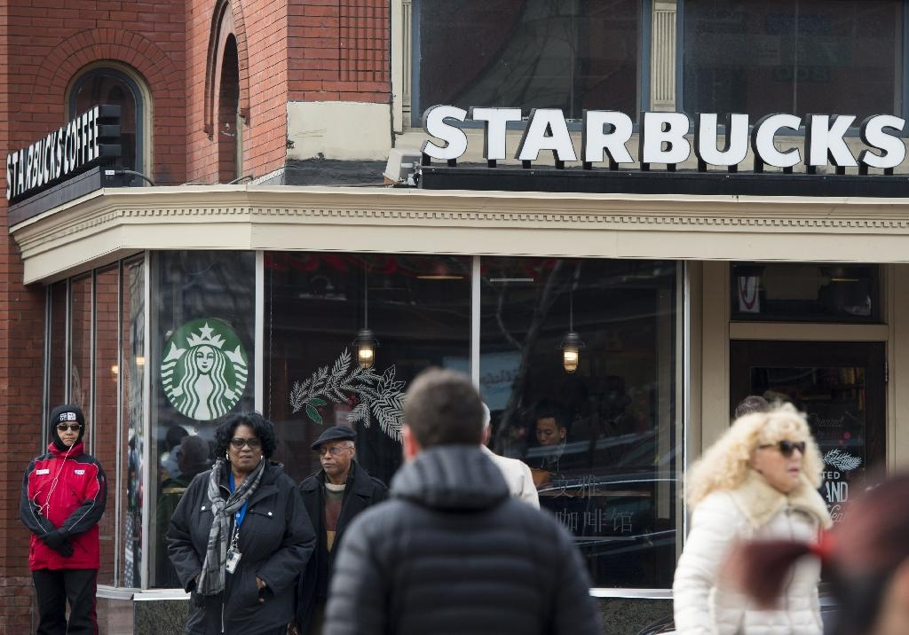 When Starbucks promised to hire 10,000 refugees it faced a boycott call from US President Donald Trump's supporters (AFP Photo/SAUL LOEB)