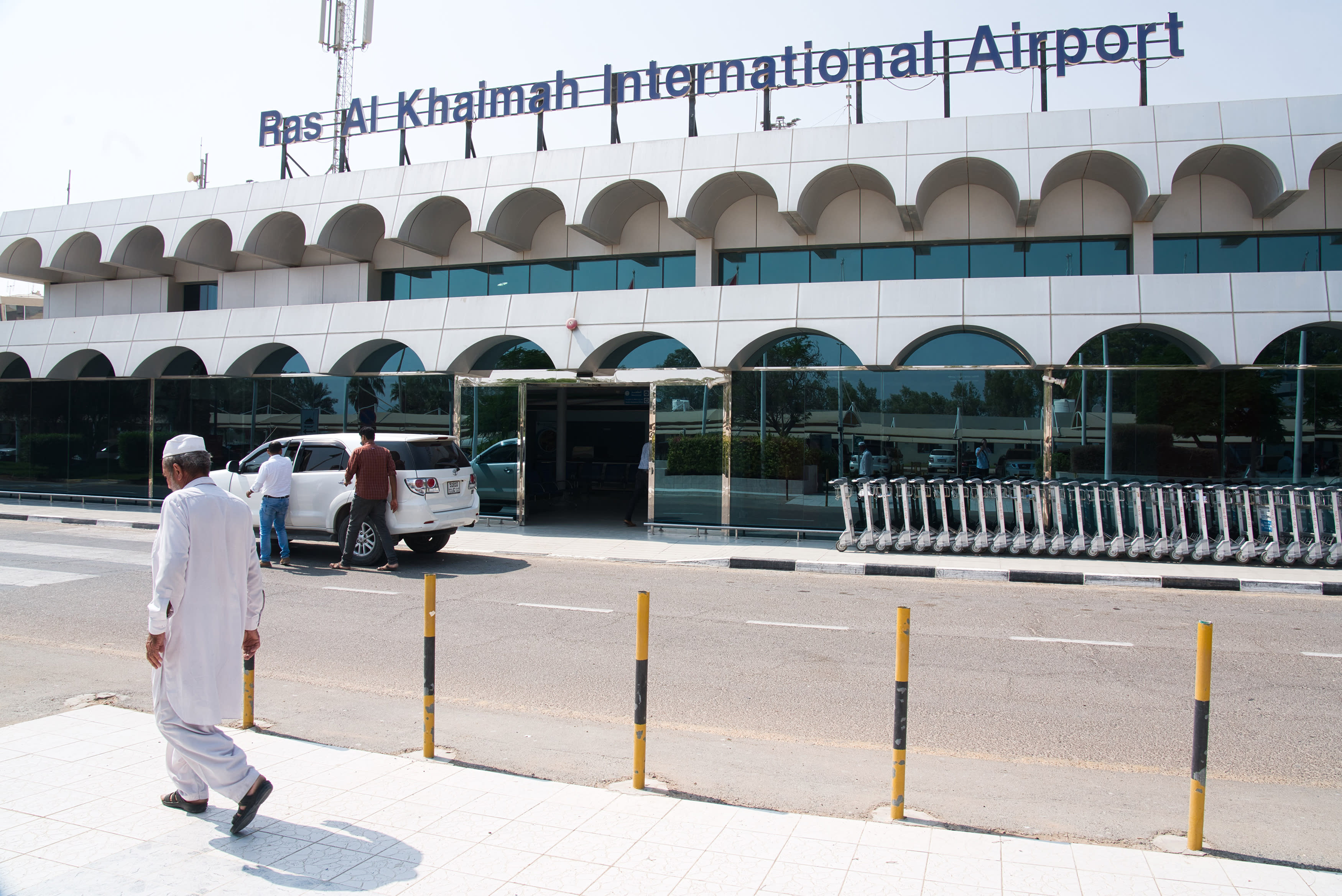 A man walks past the Ras al-Khaimah International Airport in Ras al-Khaimah, United Arab Emirates, Wednesday, Oct. 23, 2019. India's low-cost airline SpiceJet announced plans Wednesday to build its first international hub in the United Arab Emirates, offering a pledge of support to Boeing Co. by saying it would use now-grounded 737 MAX aircraft in the operation once regulators approve the planes for flight. (AP Photo/Jon Gambrell)