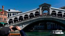 Venice calls on tourists to not swim in canals and pause too long on bridges in new responsible travel campaign