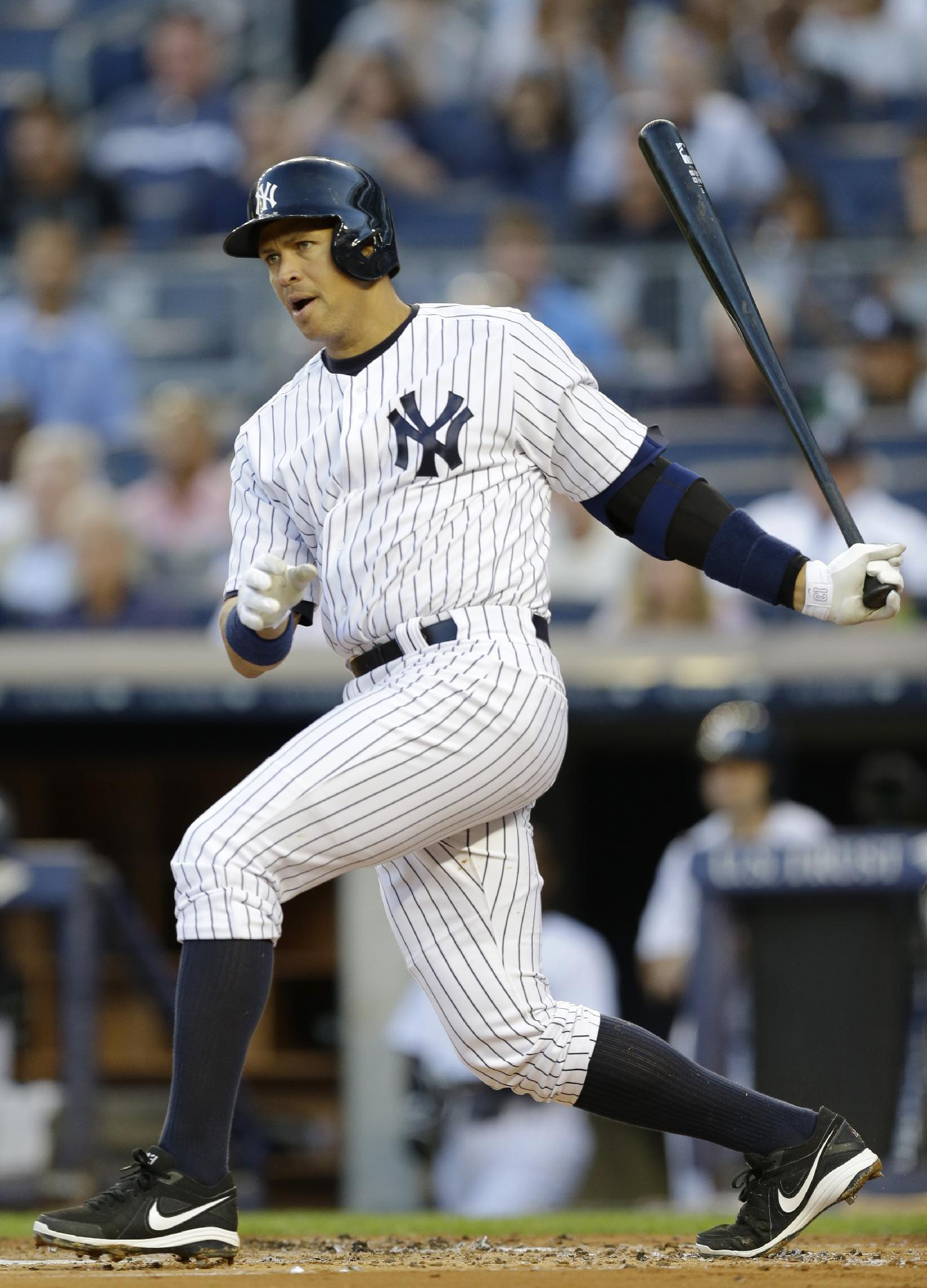 New York Yankees' Alex Rodriguez watches his first-inning double off Los Angeles Angels starting pitcher Jered Weaver in a baseball game, Wednesday, Aug. 14, 2013, in New York. (AP Photo/Kathy Willens)