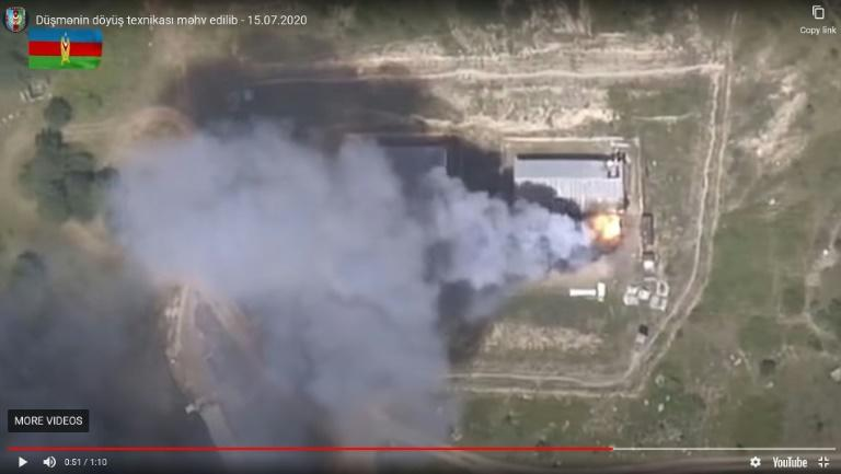An image grab taken from a video uploaded on YouTube by the Azerbaijani Defence Ministry on July 15, 2020, allegedly shows smoke billowing from what they said was destroyed Armenia's military equipment on the Azerbaijani-Armenian border. (AFP Photo/Handout)