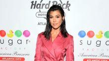 Kourtney Kardashian Claps Back at Hater Who Says She 'Never' Works