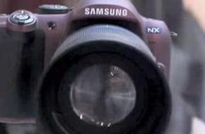 Video: Samsung NX outfitted with massive lens, teased on rotating platform