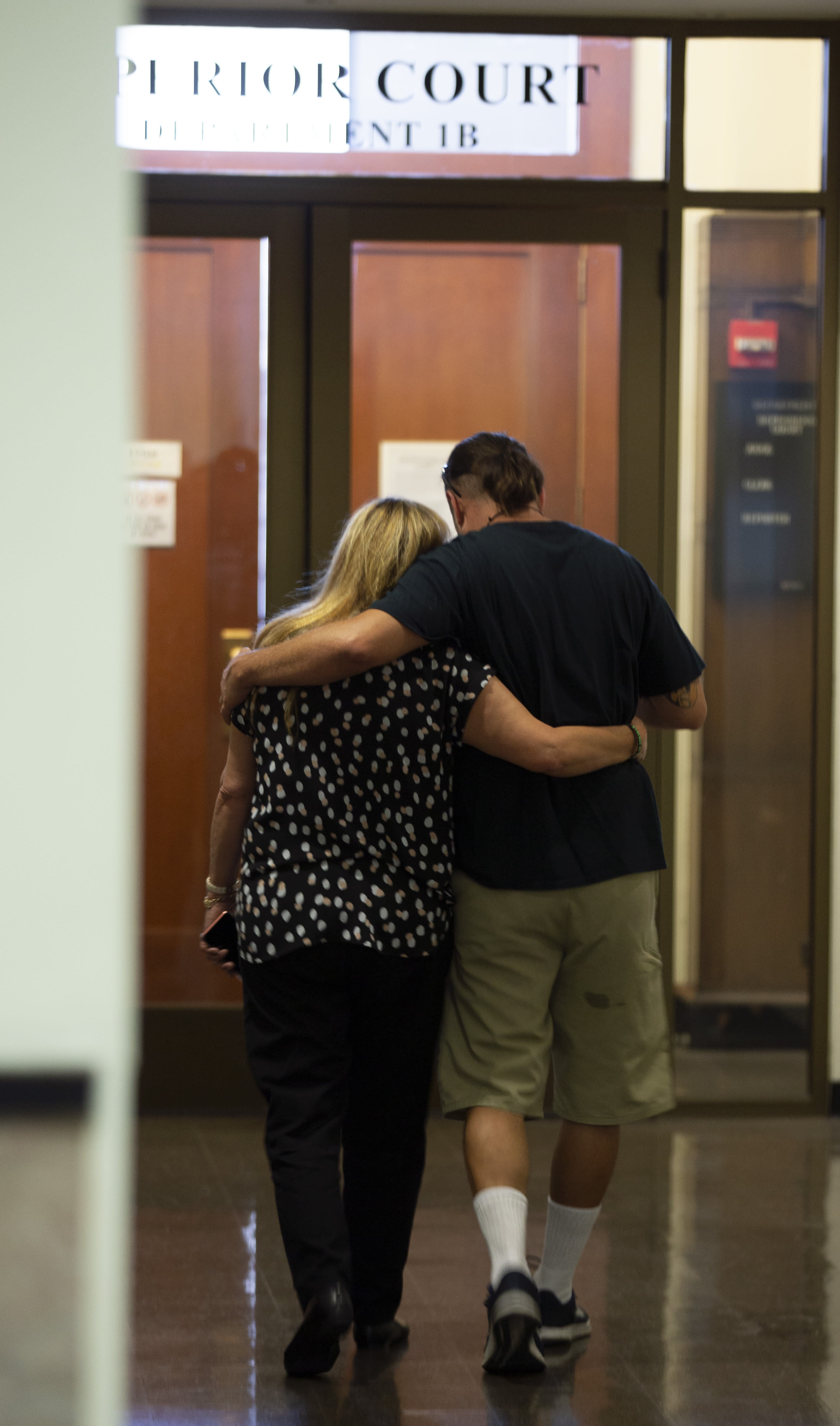 Alberto Vega, right, whose brother Alex Vega was among the 36 victims in the Ghost Ship warehouse fire, leaves the courthouse with an unidentified female companion, Thursday, Sept. 5, 2019 in Oakland, Calif. Jurors found defendant Max Harris not guilty on 36 counts of involuntary manslaughter and were unable to reach a verdict in the case against co-defendant Derick Almena. (AP Photo/D. Ross Cameron)