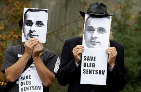 FILE PHOTO: Demonstrators attend a protest rally demanding the release of Ukrainian film director Oleg Sentsov, in Prague
