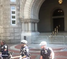 Police Guarding Trump Hotel in Washington Kneel in Front of Protesters