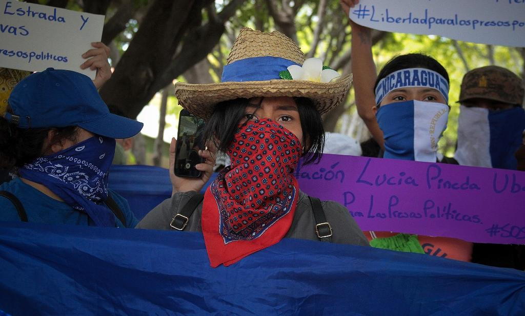 Nicaraguan students take part in a demonstration to mark 11 months since the beginning of anti-government protests, and to demand the release of political prisoners, in Managua on March 18, 2019