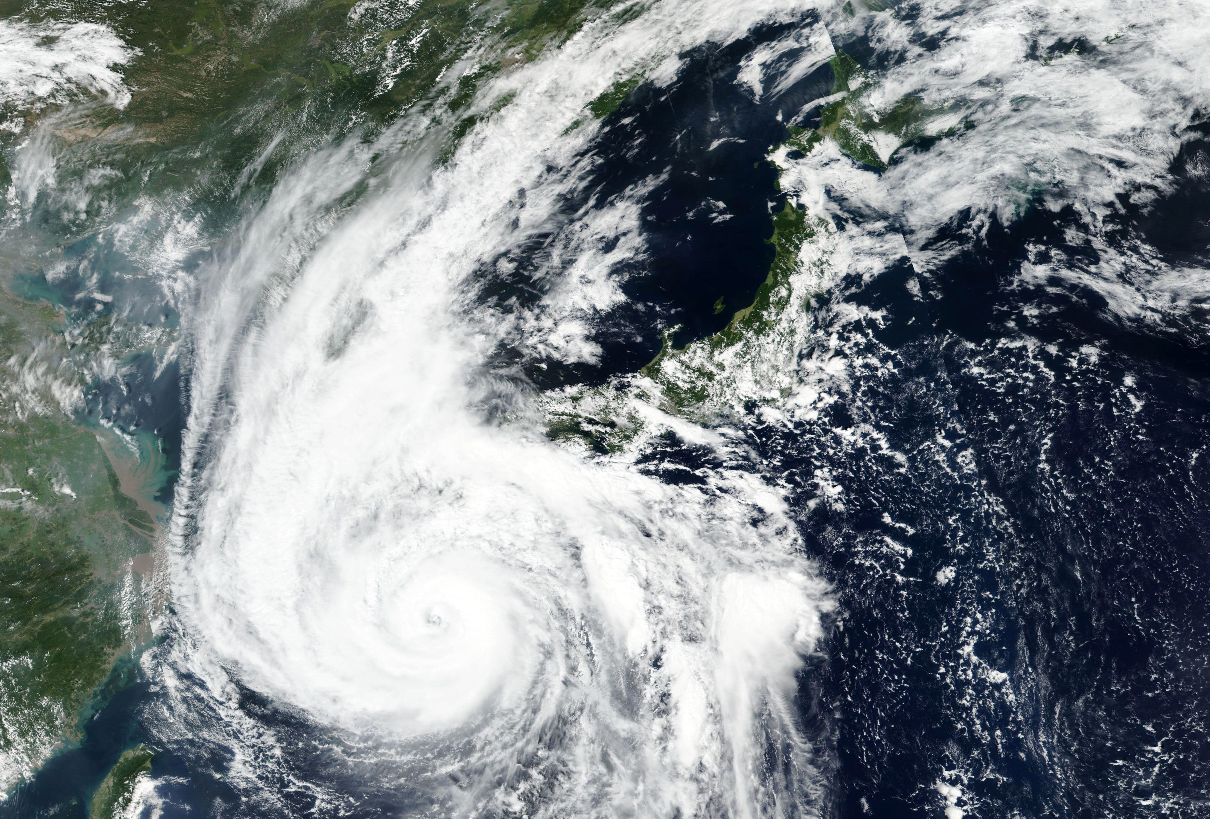 FILE - This Sept. 6, 2020, file satellite image released by NASA Worldview, Earth Observing System Data and Information System (EOSDIS) shows Typhoon Haishen barreling toward the main southwestern island of Kyushu. The second powerful typhoon to slam Japan in a week has unleashed fierce winds and rain on southern islands, blowing off rooftops and leaving homes without power as it edged northward into an area vulnerable to flooding and mudslides. (NASA via AP, File)