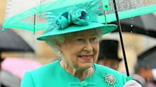 PSA: the Queen matches her umbrellas to her outfits and the photos will make you so happy