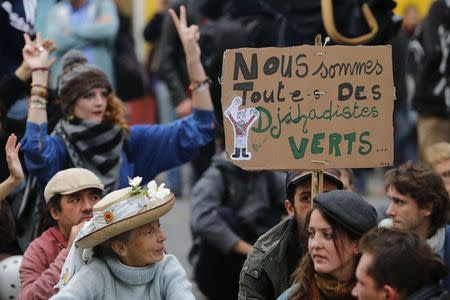 Protesters attend a demonstration against police brutality in Nantes
