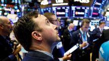 Wall Street cierra mixto, entre la Reserva Federal y la guerra comercial