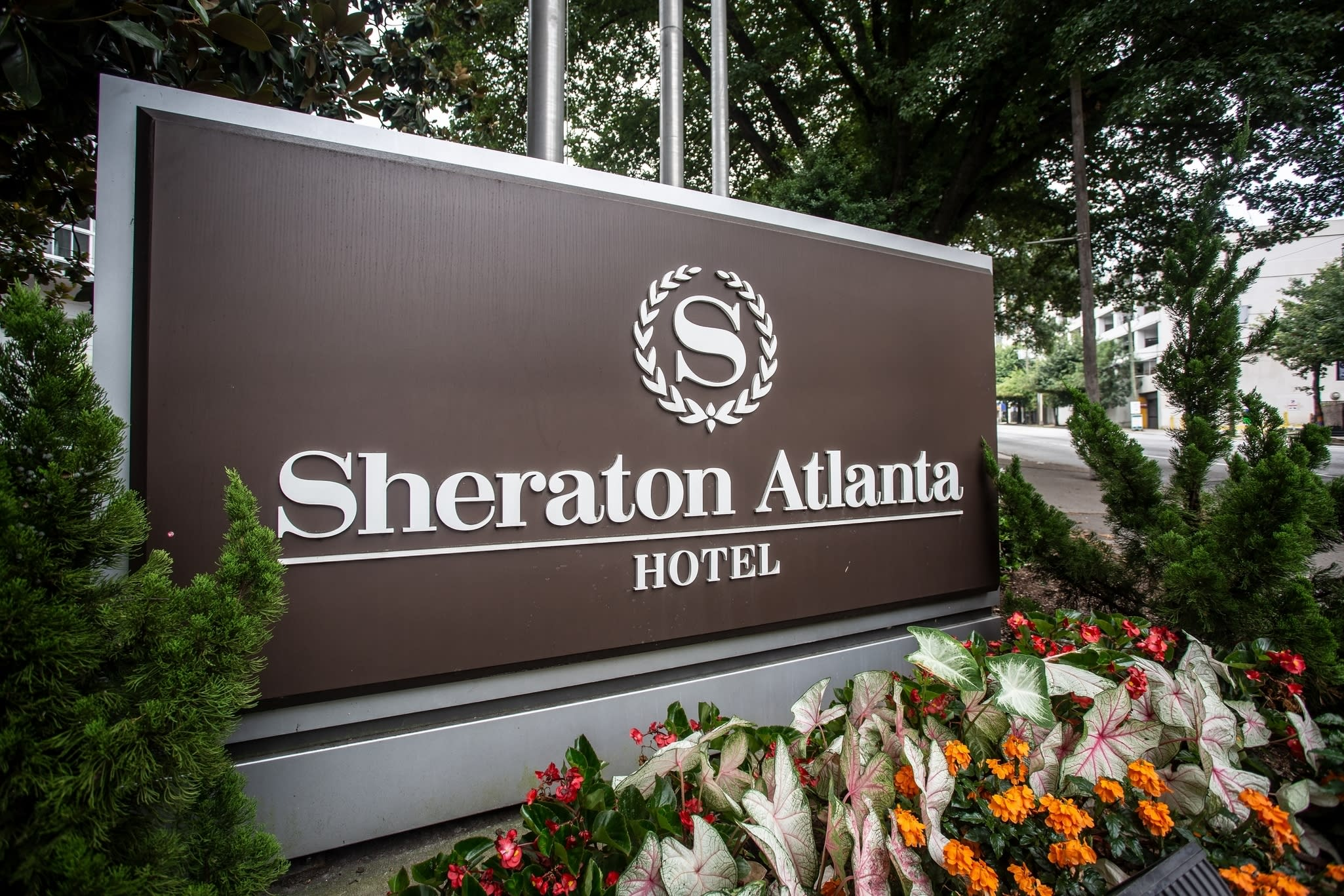 "FILE-In this Wednesday, July 31, 2019 file photo, the sign at the entrance to the Sheraton Atlanta Hotel is seen, in Atlanta. A lawsuit alleges ""negligence in the operation and maintenance of the water systems"" caused a Legionnaires' disease outbreak at a downtown Atlanta hotel. The lawsuit was filed Monday in Gwinnett County State Court by Germany Greer, who says he tested positive for the disease after attending a conference at the Sheraton Atlanta Hotel June 27-July 1. (AP Photo/Ron Harris, File)"