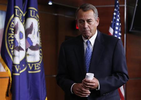 U.S. House Speaker Boehner leaves after his news conference on Capitol Hill in Washington