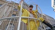 Vivienne Westwood suspended in a giant birdcage outside the Old Bailey to support Julian Assange