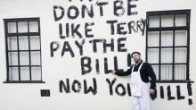 Disgruntled painter owed money daubs message on the side of pub he worked on
