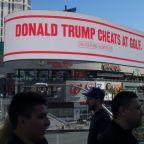'Trump cheats at golf': Bloomberg mocks president with billboard
