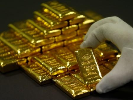 Corrected: Gold rallies to a 14-month crest as weak U.S. jobs data dents dollar
