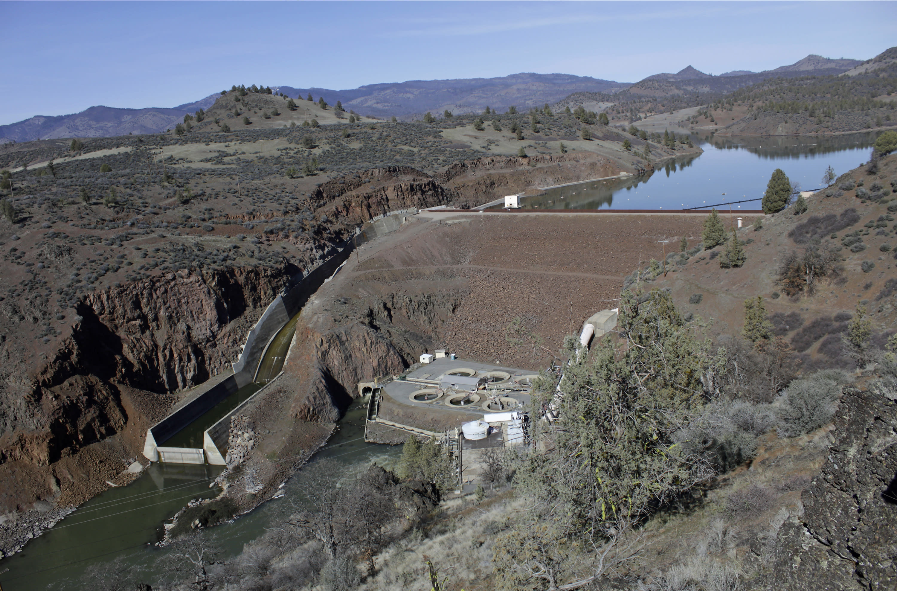 FILE - This March 3, 2020, file photo shows the Iron Gate Dam, powerhouse and spillway are on the lower Klamath River near Hornbrook, Calif. Federal regulators on Thursday, July 16, 2020, threw a significant curveball at a coalition that has been planning for years to demolish four massive hydroelectric dams on a river along the Oregon-California border to save salmon. (AP Photo/Gillian Flaccus, File)