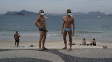 Police remove sunbathers from Copacabana as Brazil's coronavirus death toll tops 72,000