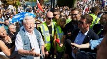 Polish government's court overhaul faces criticism from allies, mass protests at home