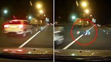 'Centimetres from death': Terrifying moment man rolls in front of car