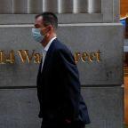 Dow tops 30,000 on vaccine progress, Biden transition