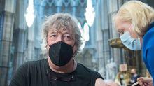 Stephen Fry gets coronavirus jab in 'spectacular' Westminster Abbey