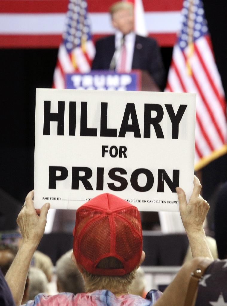 A supporter of Republican presidential candidate Donald Trump holds up a placard during a campaign rally in Kissimmee, Florida on August 11, 2016 (AFP Photo/Gregg Newton)