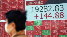 Asian shares lower as Wall St rally fizzles, oil rebounds